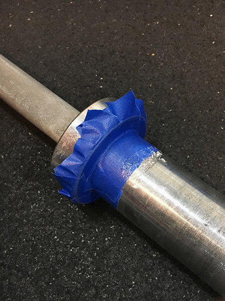 Masking tape protects the barbell from glue drips